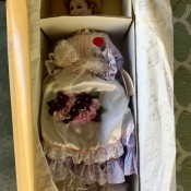 A Romantic Flower Maiden doll in the box.