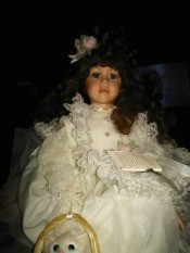 Identifying a Geppeddo Doll - dark haired doll wearing a white lace trimmed dress
