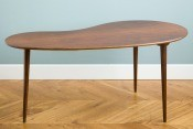 A midcentury modern wooden coffee table.