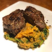 Lamb Loin Chops with Garlic Brandy Butter with sweet potaoes on plate