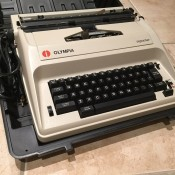 Repairing an Olympia Reporter Electric Typerwriter - typewriter in a case