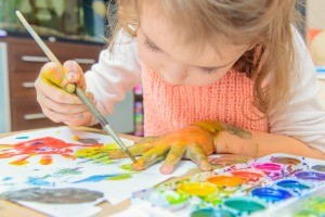 A child using watercolor paints.