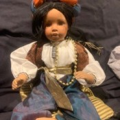 Identifying a Porcelain Doll - doll wearing a headdress, blouse, vest, and pants