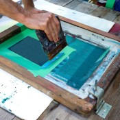 Screen Printing Tips And Tricks - person's hands working on a screen print
