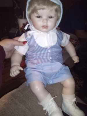 Identifying a Porcelain Doll - doll in blue pants, striped vest and white sirt