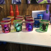 Christmas Silhouette Candle Holders - different colored jars with lights inside