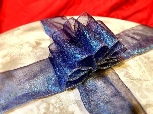 Beautiful Ribbon Gift Topper - cut other ribbon lengths for the gift and stitch the topper in place