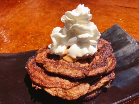 Pancakes on plate with whipped cream