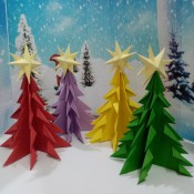 Colorful Paper Mini Table Top Christmas Tree - 4 colorful trees in front of a snowy backdrop
