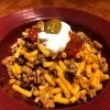Taco Mac n Cheese topped with sour cream & salsa