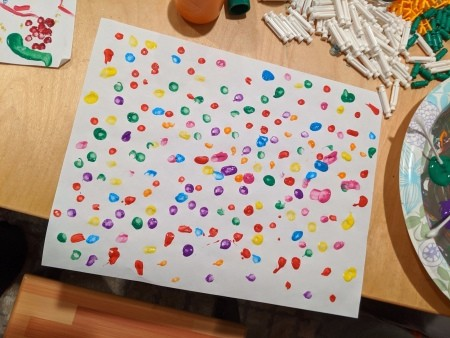 Noel Q-Tip Painting - paint dots on a piece of white paper