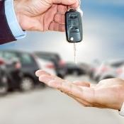 Handing over the keys for a car.