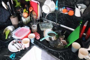 A messy and cluttered kitchen counter.
