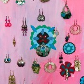 Hanging earrings stored on a piece of fabric.