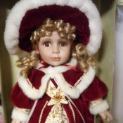 Value of a Collectible Memories Doll - doll in a red velvet coat with white fur trim