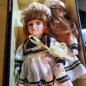 Value of DanDee Porcelain Dolls - two dolls wearing sailor style dresses in a box