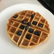 baked Waffle on plate with syrup & blueberries