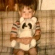 Identifying a Stuffed Raccoon - very fuzzy photo of a young boy holding a stuffed raccoon