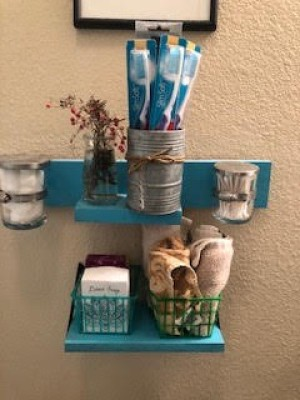 A set of organized small shelves in a bathroom.