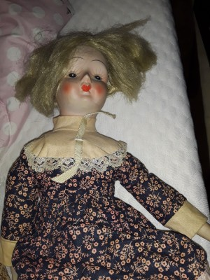 Identifying a Porcelain Doll  - older style doll in a floral dress