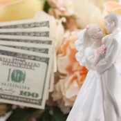 Bride and groom cake topper with cash.