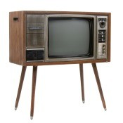 A vintage television with table legs.