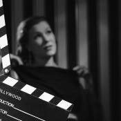 A black and white movie behind a movie clapboard.