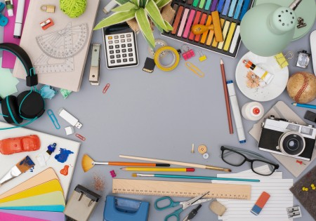 A desk filled with craft supplies.