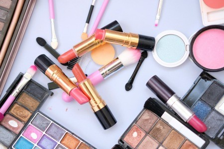 Makeup scattered on a countertop.