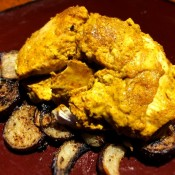 Tender Yogurt Spice Chicken on eggplant on plate