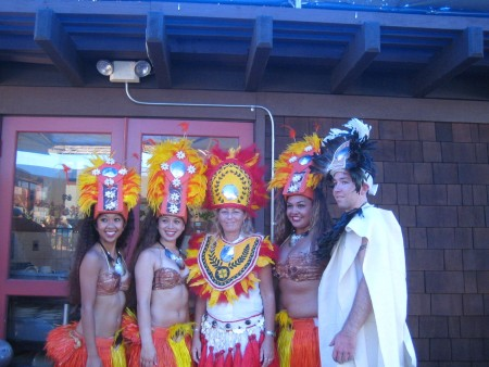 Tahitian dancers with colorful headdresses.