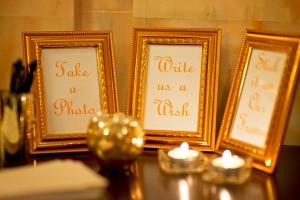 A collection of picture frames at a wedding reception.