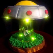 UFO Cow Abduction Cake - finished cake photo shot against a black backdrop