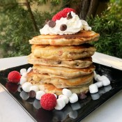 Raspberry Marshmallow Chocolate Chip Pancakes stacked on plate