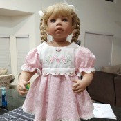 Identifying a Porcelain Doll - doll with blond braids and a pink dress