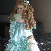 Value of Betty Jane Carter Dolls - doll with hair in long ringlets and wearing a light blue satin dress
