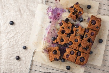 Blueberry cake cut into squares.
