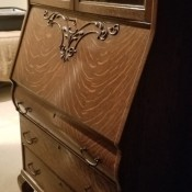 Value of an Antique Secretary Desk - drop front desk with glass doors and three drawers