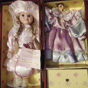Value of a Cathay Depot Collection Doll - doll in case with clothes hanging on the other side