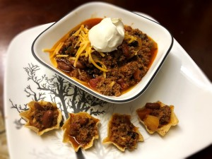 Chili in bowl with cheese & dollop of sour cream