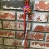Wall Shell Decoration for Valentine's Day - hanging on a brick fireplace
