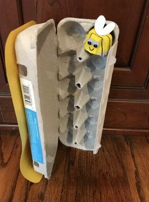 Bee and Beehive Egg Carton Toy - open hive crate with a bee in one nook
