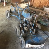 Value of a 1945 Worldwind Toro Riding Mower - old mower with a seat in tandem with the mower