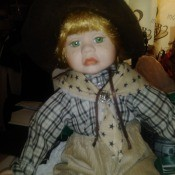 Value of a Granville House Doll - doll wearing a neck scarf and plaid chirt