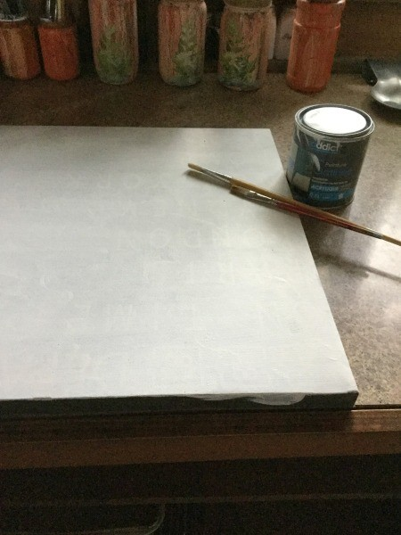 Creating a Crackle Paint Finish on Canvas - apply white paint, 2-3 layers, to canvas and allow to dry