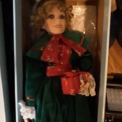 Value of a Betty Jane Carter Doll - doll wearing a long dark green coat in a box