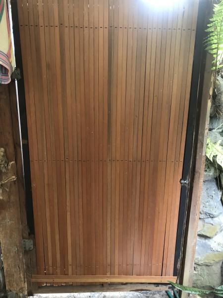 Custom Bathroom Door Design - wooden slats nailed to the door