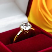 Engagement ring in a red box.