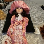 Selling Porcelain Dolls - doll wearing a long peach colored dress trimmed with lace