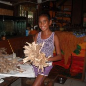 Dried Banana Leaf Crown - smiling young girl holding the finished crown
